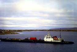 NTCL tug and barge in Cambridge Bay mid 1980's. Photograph Courtesy of Captain Todd Gilmore