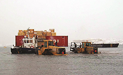Goods coming ashore in Iqaluit in 2009. Photograph Courtesy of Luc Beland Canadian Coast Guard
